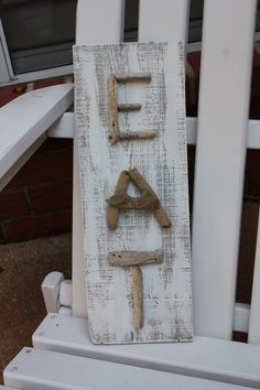 Coastal Charm: Driftwood Art. You could design other signs with other words.