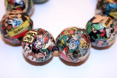 Pne-of-a-kind découpaged jewelry Craftster user Munk_Munk created using colorful scraps of comic book pages, Mod Podge, wooden beads and bangles.