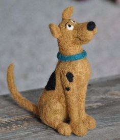 Needle Felted Scooby by fiber Artist Teresa Perleberg of Bear Creek Felting. Learn to needle felt with Teresa with her beginner needle felting kits or her online needle felting academy.