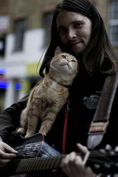 A street cat named Bob.  The magic of a twin souls meeting. I go crazy for this story