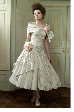 Super adorable dress from Ian Stuart that also comes in rose and multicolour roses. Could this be it?