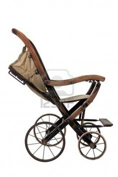 Old vintage styled baby carriage-stroller on white background Stock Photo