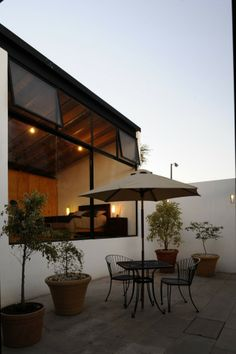 Delightful petite courtyard has a view of a handsome amber-lit interior. SPRB Architects.
