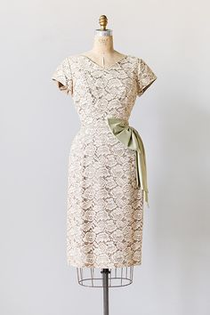 1960s cream lace wiggle party dress with lovely pale sage green silk bow and sash accented on the waist.