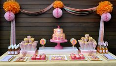 I'm just admiring the symmetry of this party table.  I would prefer to add some cake pops though