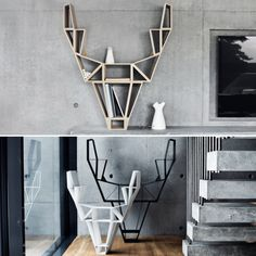 Bookshelves don't necessarily need to be rectangular, which is why we are drawn to the Deer Shelf by #bedesign! Inspired by wild #deer, this shelf takes on their appearance and the geometric shapes gives it a cool, edgy feel. #design #designs #we #love #books #furniture #decor #art #wood #solid #oak #lifestylespacedesign #nyc #newyork