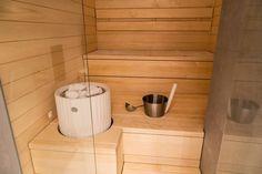 This Riite sauna heater by Tulikivi looks great in this modern Finnish sauna. Photo by Joni Arpinen