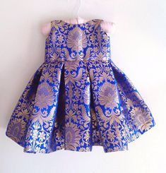Royal blue brocade dress with bow at back 💙 Available in different colours Perfect for coming festive season ✨ Girls Frock Design, Kids Frocks Design, Baby Frocks Designs, Baby Dress Design, Baby Girl Frocks, Frocks For Girls, Dresses Kids Girl, Girl Outfits, Kids Dress Wear