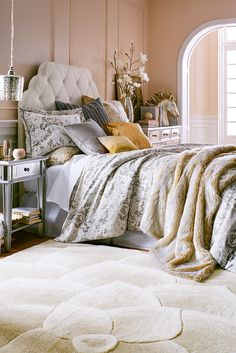 In this setting fit for a princess, snuggle into a luscious faux fur spread and rest your head on Pier 1's fabulous plush pillows. With one touch of our jacquard bedding, it hits you: This is a fairy tale come true. No matter the time of day, in this bedroom, with a hand-tufted Hayworth Upholstered Headboard and glamorous mirrored furniture, you're exactly where you've always wanted to be. Sweet dreams.