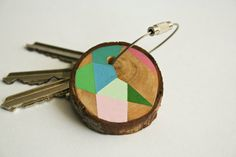 hand painted Pine wood keychain with stainless steel cable wire, tones of baby pink, light blue, light green geometric triangle shapes. $15.00, via Etsy.