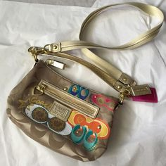 """Coach Poppy crossbody! NWOT Coach Poppy Daisy Pop C appliqué crossbody converter shoulder bag! New without tags! Never used still has tissue on the inside zipper! 100% authentic Guaranteed! Creed serial number inside the bag! Pop C print fabric with fabric trim!  11 1/4"""" (L) x 7 3/4"""" (H) x 3 1/2"""" (W), Handles with 7"""" drop Inside zip, cell phone and multifunction pockets Outside zip pocket, Zip-top closure, fabric lining, Two hangtags Coach Bags Crossbody Bags"""