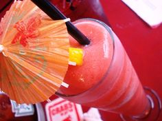 Non Alcoholic Strawberry Daiquiri.  ===1 ounce orange juice    3 ounces frozen strawberries in syrup    2 teaspoons sugar    Ice