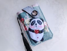 Show your style and have some fun with this beautifully 90% hand-stitched and 10% machine embroidery pouch to protect your cell phone or favorite gadg