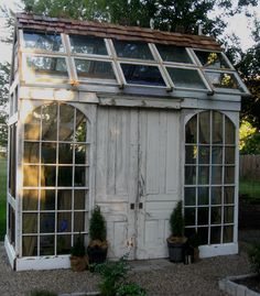 Repurposed old windows into garden house