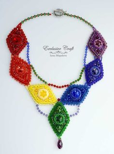 "I wanted to create a beaded necklace using all of the rainbow's colors. Jewelry that you can wear with anything! For design of this beautiful beaded necklace ""Rainbow"" I used different kind of Swarovs"
