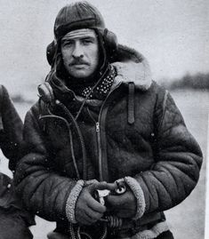 British aviator wearing his RAF issue Irvin jacket, to keep you warm in those unheated cockpits at high altitude as you fly your mission.