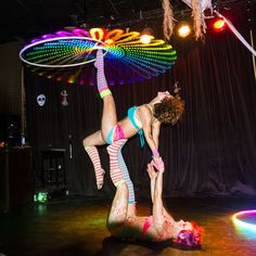 Ahni Radvani and Erin Rosenthal of The Electric Fairies team up for some awesome acro-hooping at the Goddess Glowlight Party. Photo by Sarah Swaty of Sarah Swaty Photography.