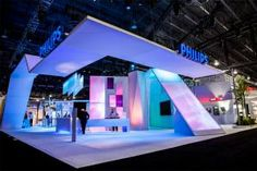 A crisp white foundation showed off Philips lighting products in the company's booth at the 2013 Lightfair in Philadelphia. A custom color-changing chandelier, inspired by an organ, presided over the 10,200-square-foot space, created by Global Experience Specialists.