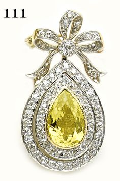 Edwardian Pear-shaped tourmaline, diamond, gold and platinum pendant/brooch. Rare color for a tourmaline.