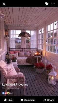 What a nice glassed-in porch! Looks so cozy and inviting. <3