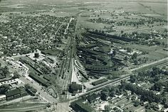 Aerial view of the railroad depot along East Main St. Of course, all but a few of these structures are now gone, and the overpass carries cars across the last set of railroad tracks that cross E. Main St.