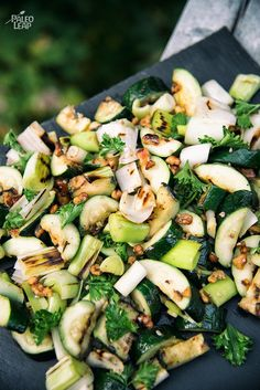 Grilled Zucchini And Leeks With Herb Dressing - Dive into this zucchini and leek-filled side dish lightly coated in an olive oil herb dressing topped with toasted walnuts.