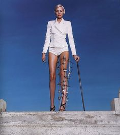 And so it starts,  Nadja in leg brace by Helmut Newton for VOGUE 1995