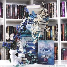 I figured I should do a #winterbookstack for #stacksaturday I loved the #shattermeseries and am so excited there will be another! Are you a fan? #shatterme #unravelme #bookspiral #bookstack #bookombre #ombrebooks #taherehmafi #bookshelves #shelfie #stacksaturday #wintervibes