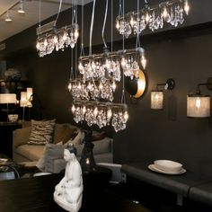 Tribeca Bar Chandeliers hung at varying heights.  Can't decide if this is cool or cluttered.  Lol