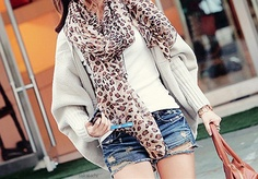 distressed short shorts, big sweater, and a scarf