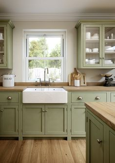 A farm kitchen cabinets that can be used as ideas for your home.A farm kitchen cabinets that can be used as ideas for your home. Sage Green Kitchen, Green Kitchen Cabinets, Farmhouse Kitchen Cabinets, Cottage Kitchens, Kitchen Cabinet Colors, Kitchen Colors, Home Kitchens, Green Country Kitchen, Vintage Kitchen Cabinets