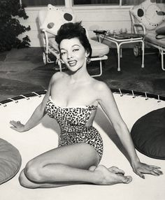 Mari Blanchard. You know your outdoor furniture is exceptional when the eye goes to it instead of the sexy mama in a leopard bathing suit!