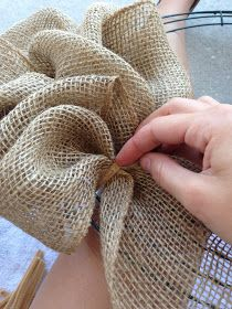 Little Lovely Leaders: Burlap Wreath!! I've always wanted to know how they did this type of fabric wreaths...have seen it done with different types of ribbons as well. clever...very clever