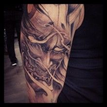 Half sleeve black and grey Hannya Mask tattoo