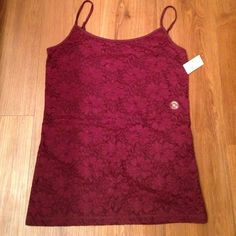 Lace front tank cami Brand new with tags, brand Aeropostale size XL. Has adjustable straps. Lace is just on the front. Retail price $19.50. Material: 45% cotton, 45% nylon, 10% spandex. Very soft material. Aeropostale Tops Camisoles
