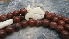 Red Seed Jasper Mala   https://www.etsy.com/listing/156920640/red-sesame-jasper-mala-prayer-beads?ref=shop_home_active