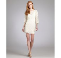 If I ever thought I could wear white without it getting ruined within 5 minutes, I would totally wear this.  Laundry by Shelli Segal warm white lace bell sleeve dress