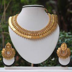 Shop White Stone Laxmi Temple Coin Gold Necklace Set by Traditionalindia online. Largest collection of Latest Necklaces online. ✻ 100% Genuine Products ✻ Easy Returns ✻ Timely Delivery