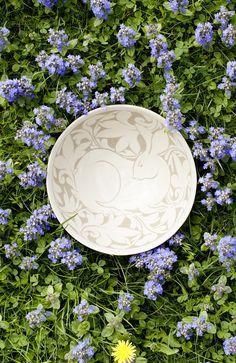 A Miranda Thomas Cream Carved Bowl with a Rabbit Motif