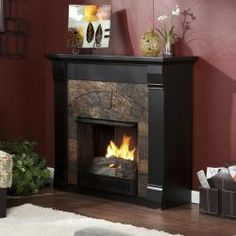 @Overstock - Increase the heat level and add a focal point in your home with this portable gel fuel fireplace in a neutral black finish. The gorgeous faux slate tiles add a designer touch, while the gel fuel provides the illusion of a real crackling fire. http://www.overstock.com/Home-Garden/Stonegate-Black-Gel-Fuel-Fireplace/6228268/product.html?CID=214117 $399.99