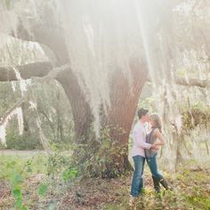 Christy and Sterling stood beneath a gorgeous tree dripping with light, accentuating the beauty of nature. The couple especially wanted to take their engagement photos in nature because of their mutual love of the outdoors. Photographer Credit: Claire Pacelli - See more at: http://inblissweddings.com/real-weddings/story/christy_and_sterling/360#sthash.VlFS6DxR.dpuf
