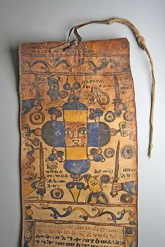 Healing Scroll Date: 18th–19th century. Parchment, ink, pigments, cotton. In Ethiopia customized protective scrolls that interweave sacred imagery with textual prayers have been prescribed by traditional healers for over two thousand years.  Often the customized content of a scroll is astrologically determined. http://www.37thstateonline.com/post/48926218071/just-a-little-history-healing-scroll-date