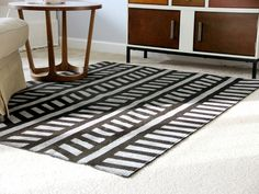 How to Paint an Upcycled Rug >> http://www.diynetwork.com/decorating/how-to-paint-a-patterned-rug/pictures/index.html?soc=pinterest