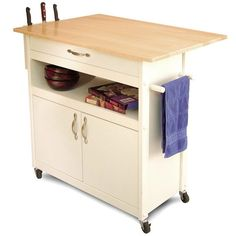 Drop Leaf Utility Butcher Block Kitchen Island Cart-Drop Leaf Utility Butcher Block Kitchen Island Cart Featuring a drop leaf, open and enclosed stora Kitchen Furniture, Cottage Kitchen, Kitchen Cart, Furniture, Portable Kitchen, Butcher Block Kitchen, Kitchen Tops, Drop Leaf Kitchen Island, Kitchen Island Cart