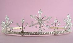 The Snowflake wedding tiara is a stunning mid winter inspired tiara design featuring three handcrafted swarovski crystal snowflakes surrounded by more swarovski crystals. Available in gold or silver and a fabulous range of colours.