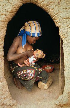 Niftine Sawadogo feeding her newborn baby in Kalsaka village, Yatenga Province, Burkina Faso
