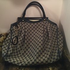 """Gucci Sukey Large Tote Original Gg canvas tote.                                         Date Authenticity code 211943-002123.               Measurements 17"""" L*7"""" W*12""""H.                              One zip pocket.   Handle drop 7"""".                          Double rolled leather handles.                              Inside this stained a little blue, just like the banks where this skin.. Good condition! Gucci Bags Totes"""