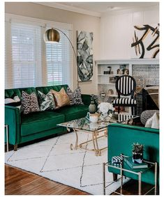 #green #couch #black #and #white #rug [New] The 10 Best Home Decor (with Pictures) -  #BonillAbode Living Room Happy Monday Social Fam and Hello Good Looking #LivingRoom! We are LOVING our updated living room. We sold our blue #couch smaller white rug and round #coffeetable as well as unused accents in exchange for this new setup. Im loving how all the dark #emeralds and olive #green tones looks with the gold and of course the black and white stripes! Yes Im slightly crazy because Im already… Blue And Gold Living Room, Living Room Accents, Living Room Green, Living Room Update, Living Room Sofa, Rugs In Living Room, Living Room Designs, White Rug, Happy Monday
