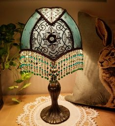 The King Georgeis a regal table lamp in rich hues with emerald silks, antique textiles and ...