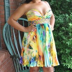 """Multi-colored Rainbow Prom/Special Event Dress Only worn once! Gorgeous patterned dress with beading around a cinched waist. Hits just above the knee (I'm 5'4""""). Sweetheart neckline. Few little snags here and there but nothing that is visible when wearing. High quality, sturdy material Dresses Prom"""